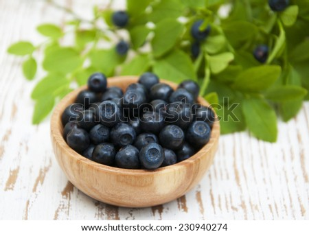 fresh ripe blueberries  on a wooden background