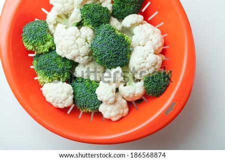 Fresh ripe broccoli piece and cauliflower cabbage vegetables - stock photo