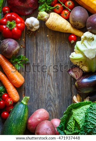 Fresh ripe colorful vegetables on old wooden board. Healthy food concept.