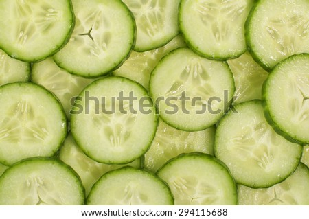 Fresh ripe cucumber slices background - stock photo