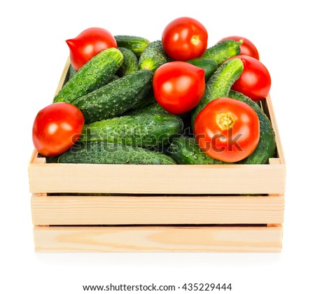Fresh ripe cucumbers in wooden box isolated on white background - stock photo
