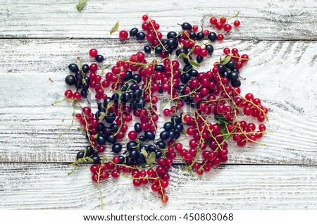 Fresh ripe currant berries bowl on wooden table background - stock photo