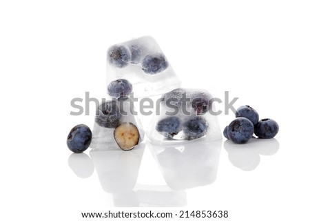 Fresh ripe delicious blueberries frozen in ice cubes isolated on white background. Fresh summer berry fruits. Healthy eating.  - stock photo