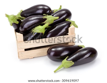 Fresh ripe eggplants (Solanum melongena) in wooden crate