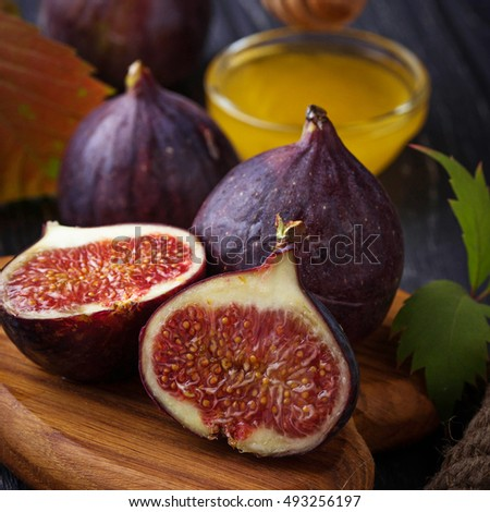 Fresh ripe figs and honey. Selective focus, square image