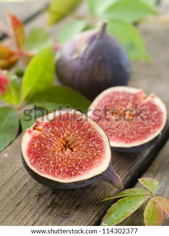 Fresh ripe figs on natural background, selective focus