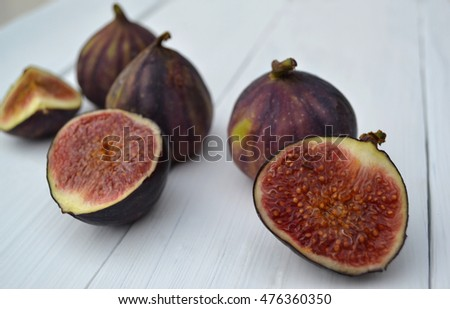 Fresh ripe figs on wooden background.  Selective focus.