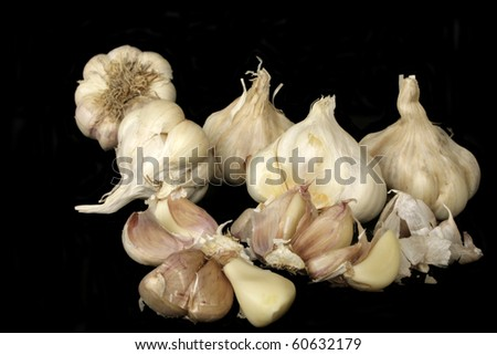 Fresh ripe garlic in isolated over black background