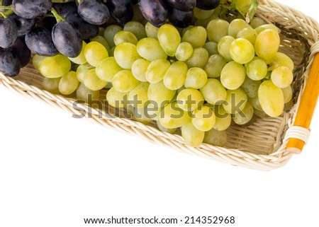 Fresh ripe Grapes in Wicker basket isolated in white background