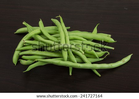 Fresh ripe Green beans heap on the wooden background