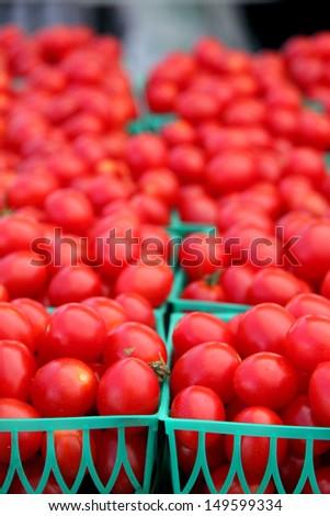 Fresh, ripe, juicy cherry tomatoes at the farmers market - stock photo