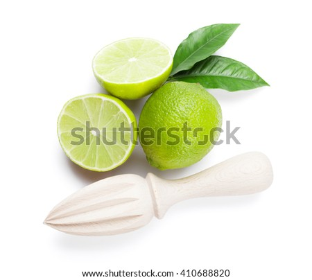 Fresh ripe limes and juicer. Isolated on white background. Top view - stock photo