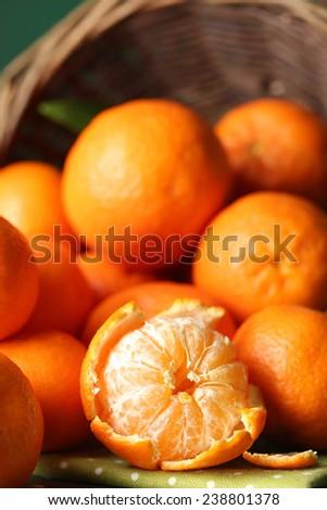 Fresh ripe mandarins in wicker basket, close-up - stock photo