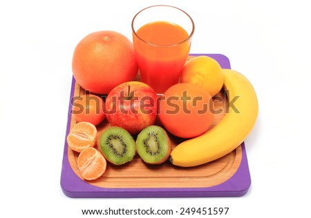 Fresh ripe natural fruits and glass of juice on cutting board, apple, grapefruit, banana, lemon, orange, kiwi, concept for healthy nutrition and strengthening immunity