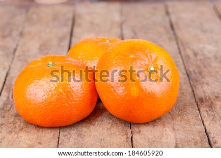 fresh, ripe orange mandarins on wooden background