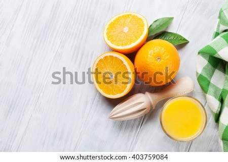 Fresh ripe oranges and juice on wooden table. Top view with copy space - stock photo