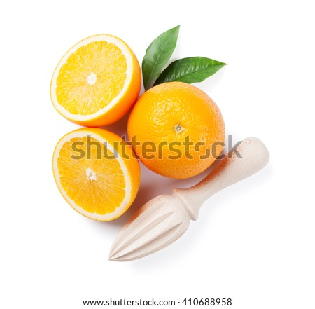 Fresh ripe oranges and juicer. Isolated on white background. Top view - stock photo