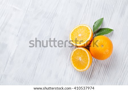 Fresh ripe oranges on wooden table. Top view with copy space - stock photo