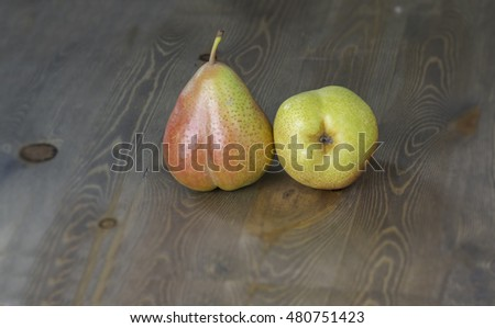 fresh ripe organic pears on wooden table