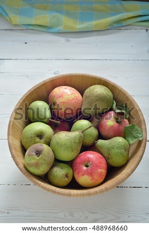 Fresh ripe pears and apples