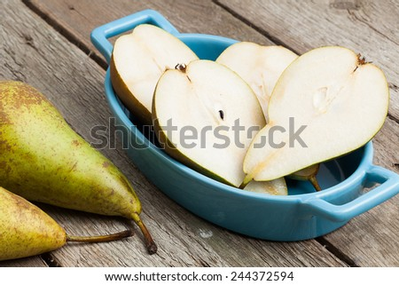 Fresh ripe pears on wooden background. - stock photo