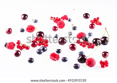 Fresh ripe raspberries, blueberries and cherries on white background