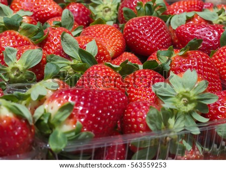 Fresh, ripe, red strawberries at the market stalls.