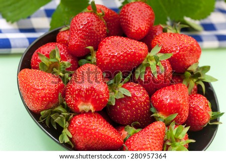 Fresh ripe red strawberries in a bowl - stock photo