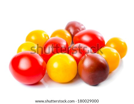 Fresh ripe red, yellow and black cherry tomatoes is isolated on the white background - stock photo
