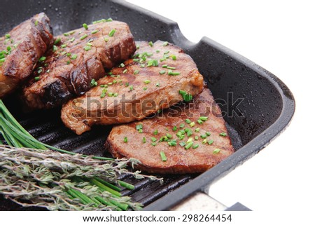 fresh ripe roasted beef meat on barbecue pan with thyme and pepper isolated on white background - stock photo