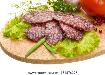 Fresh ripe salami with vegetables