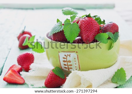 fresh ripe strawberries in a bowl on the table. berries from my garden. selective focus - stock photo