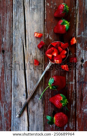 Fresh ripe strawberries in vintage spoon on Wooden Background. Summer or Spring Organic Berry over Wood. Agriculture, Gardening, Harvest Concept. Top view. - stock photo
