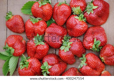 Fresh ripe strawberries on old wooden background - stock photo