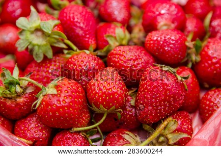 Fresh ripe strawberry - food full frame background or texture