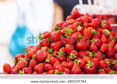 Fresh ripe strawberry on a market counter