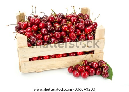 Fresh, ripe sweet cherries (Prunus avium) in wooden crate