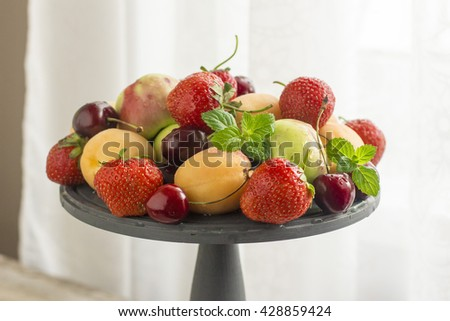 Fresh Ripe Sweet Fruits on the Wooden Table . Fresh Organic Food. Fresh Berries - stock photo