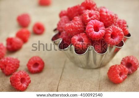 Fresh ripe sweet raspberries, selective focus - stock photo