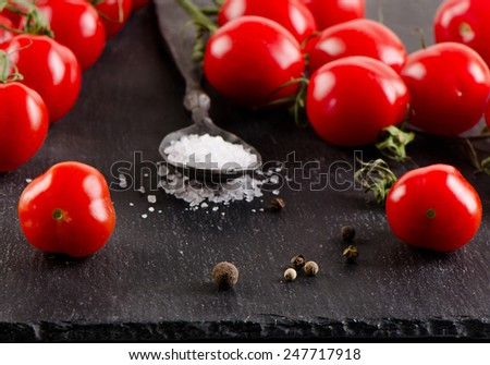 Fresh ripe tomatoes on   black background. Selective focus - stock photo