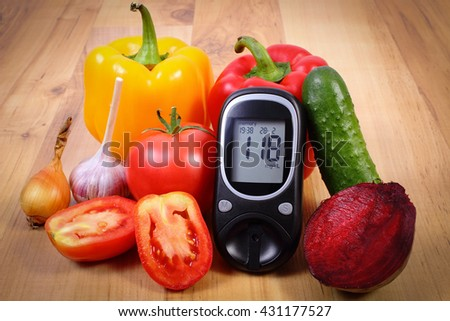 Fresh ripe vegetables and glucose meter on wooden table, diabetes, healthy lifestyle and nutrition, result of measurement of sugar