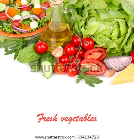 Fresh ripe vegetables and herbs and the Greek salad with cheese balls on an orange plate and on a white background with a place for the text. - stock photo