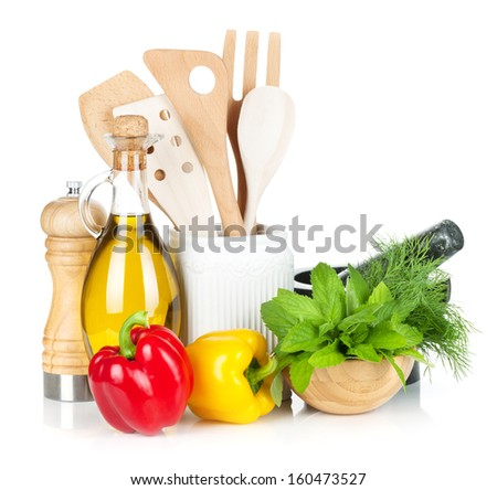 Fresh ripe vegetables, herbs and kitchen utensils. Isolated on white background