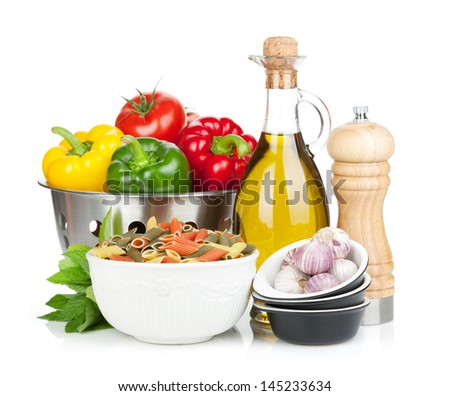 Fresh ripe vegetables in colander, pasta, herbs and condiments. Isolated on white background - stock photo