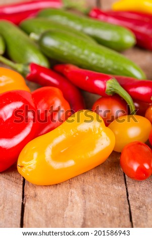fresh ripe vegetables on a wooden background