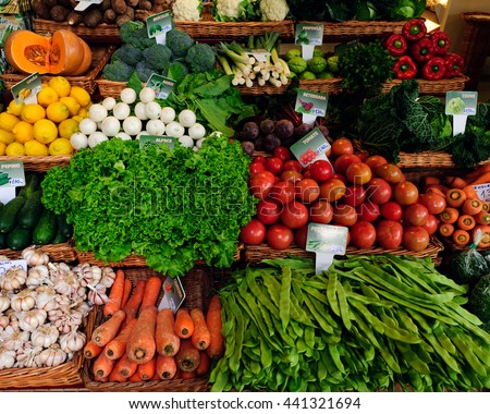 Fresh ripe vegetables on shelves in Mercado dos Lavradores, Funchal, Madeira island, Portugal. - stock photo