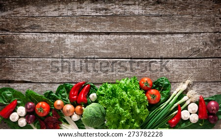 Fresh ripe vegetables on wooden table background - stock photo