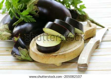 fresh ripe vegetables purple eggplant  on a wooden table