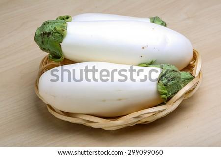 Fresh ripe White eggplants on the wood background  - stock photo