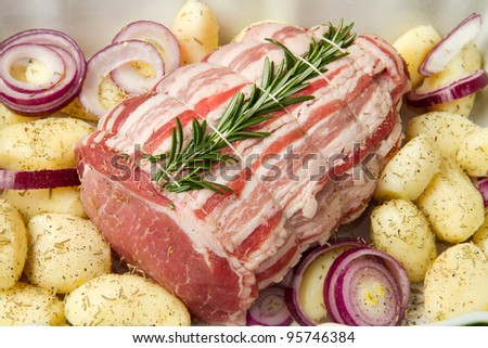fresh roast of veal with rosemary and  potatoes - stock photo